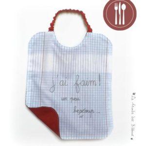 Bavoir de cantine en coton motif cahier d'écolier doublé coton rouge personnalisé avec écriture. Original fait main.