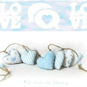 Guirlande de  cœurs  en tissus bleu pastel aux motifs enfantins  sur corde brut Original fait main
