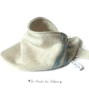 Bandana, tour de cou, enfant. Tissu coton sweat-shirt beige chiné.Surpiqué rubans bleu. Original.