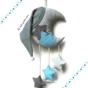 Lune et ses étoiles gris et bleu turquoise avec bonnet de nuit à suspendre . Unique et original.Fait main.
