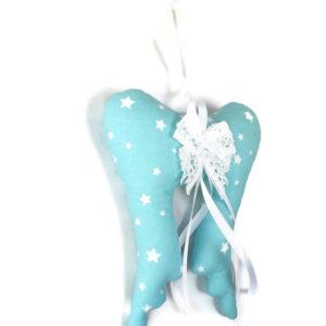 Ailes d'ange. Décoration de noël à suspendre en tissu bleu turquoise étoiles blanches.