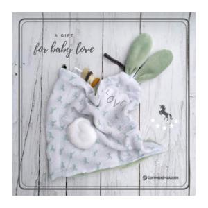 Doudou  oreilles de lapin motif licorne, tissu gaze de coton , doublé Teddy vert doux et moelleux.